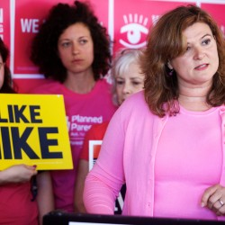 Nicole Clegg, chairwoman of Planned Parenthood Maine's Action Fund PAC, announces the organization's endorsement of Mike Michaud for governor at an event in Portland on June 16.
