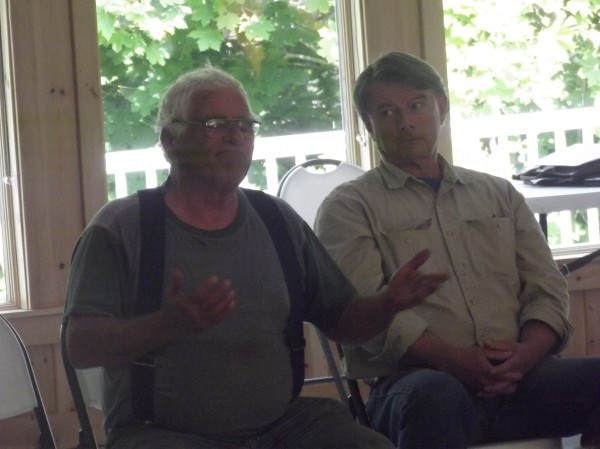 Leo Murray (left) of Lubec gestures while talking at a meeting of scallop fisherman in Dennysville Tuesday afternoon. State officials shared information about the scallop fishery and listened to fishermen.