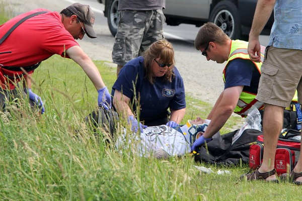 Emergency responders treat an unidentified man injured in an accident near 89 Ingraham Drive in Owls Head on Saturday afternoon.
