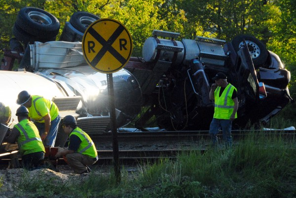 A tanker truck was hit by a train at the Verso Paper Co. mill's north gate on Saturday.