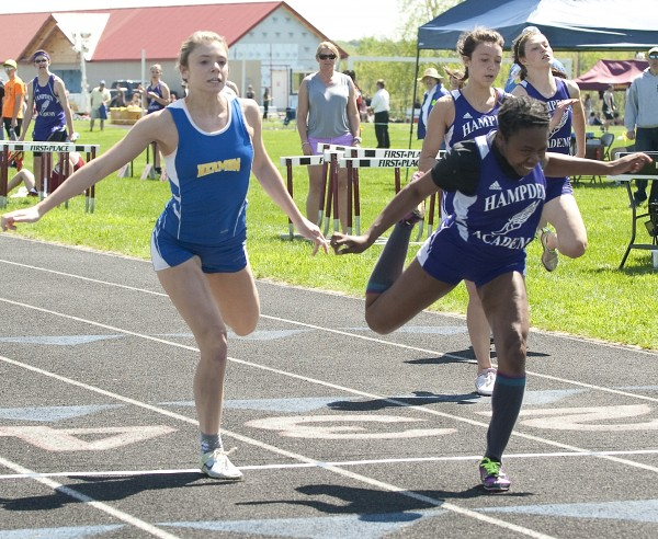Krystal Grant of Hampden (right) nips Hermon's Maddie Page (left) at the finish of the finals in the 100-meter dash during the Penobscot Valley Conference large school track and field championships in Caribou Saturday.