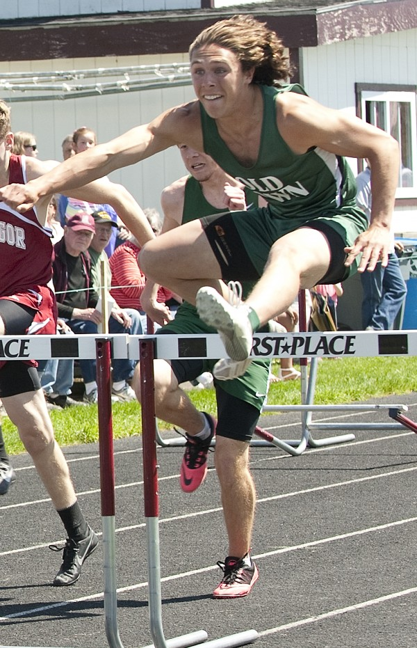 Charles Moody of Old Town clears a hurdle during the 110-meter event held Saturday at Caribou High School during the PVC Large School Track and Field Championships.