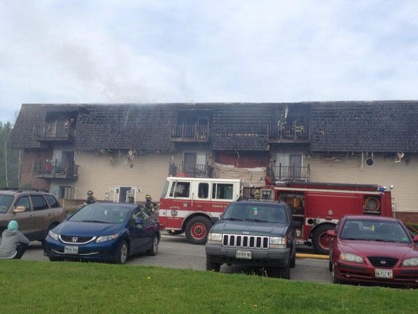 Firefighters battle a blaze at the Deerfield apartment complex on Ohio Street in Bangor on Monday morning.