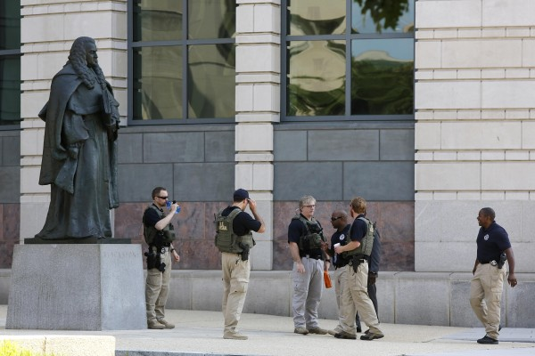 U.S. Federal Marshals patrol outside the U.S. federal courthouse on Saturday in Washington.