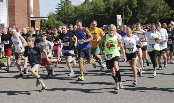 Runners and walkers take off at the fourth annual Amy, Coty and Monica 5K in Dexter Sunday morning, June 22, 2014.