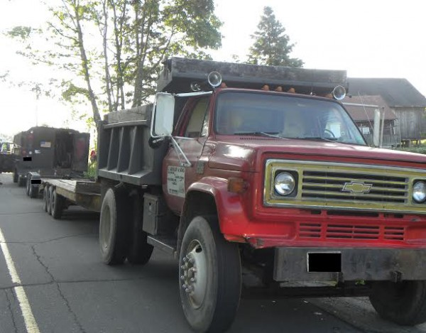 Jason Gourley, 42, a self-employed contractor, was pronounced dead on Range Road in Atkinson on Saturday morning after the tractor he was driving fell from these flatbed trucks and rolled down an embankment, police said.