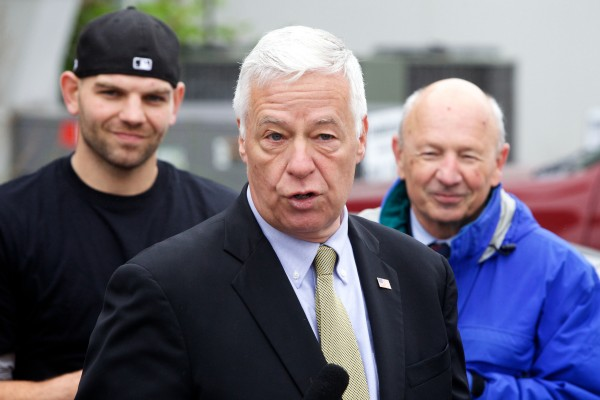 U.S. Rep. and gubernatorial candidate Mike Michaud is flanked by Zach Rand of Becky's Diner (left) and Mayor Michael Brennan at a solar energy press conference in Portland on May 27.