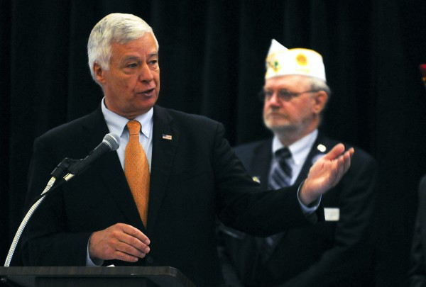 Congressman Mike Michaud (left) speaks at the American Legion convention Saturday at the Cross Insurance Center in Bangor.