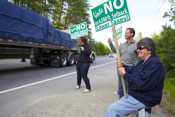 From left, Deanna Lee, Mike Smith, Becca Folster and Jan Logan wave Vote No signs on Airline Road in Clifton during election day. The vote determined the setback distance of the Clifton wind farm.