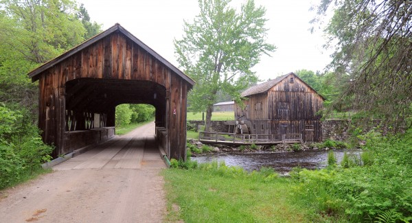 The covered bridge and water-powered sawmill at the Maine Forest and Logging Museum in Bradley.