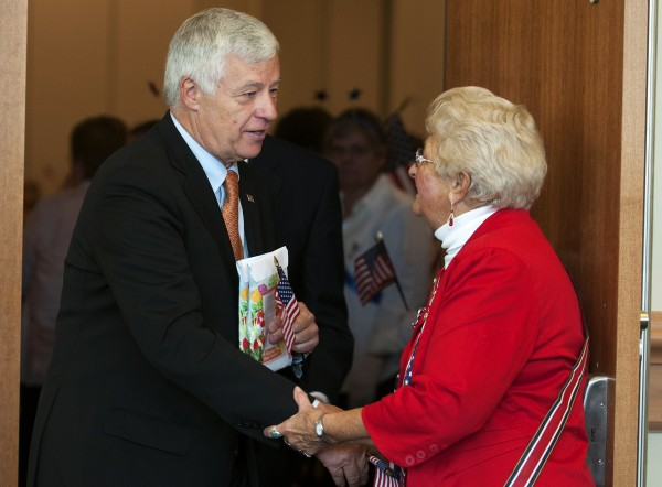 Congressman Mike Michaud (left) shakes hands with Betty Seeley after a speech at the American Legion convention Saturday at the Cross Insurance Center in Bangor.
