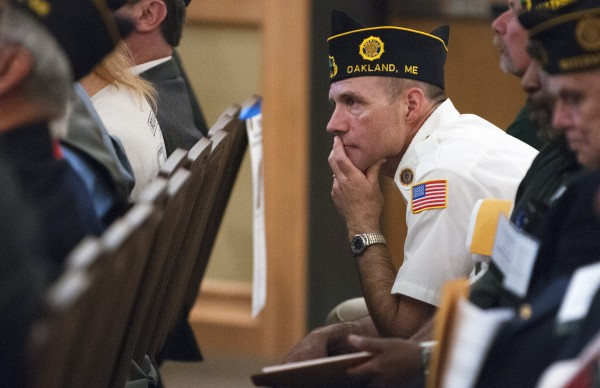 Michael Letourneu listens as Rep. Mike Michaud speaks at the American Legion convention Saturday at the Cross Insurance Center in Bangor.