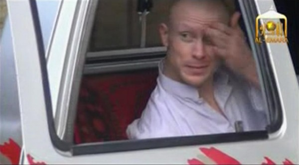 U.S. Army Sgt. Bowe Bergdahl waits in a pickup truck before he is freed at the Afghan border, in this still image from video released June 4.