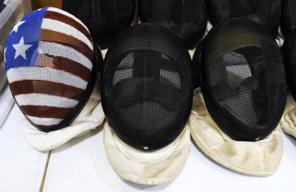 Fencing helmets wait for participates during the Downeast School of Fencing class at the Herbert Sargent Community Center in Old Town.