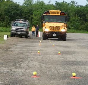 School bus drivers attending a regional safety conference on Wednesday at Narraguagus High School participated in a driving competition to test various skills.