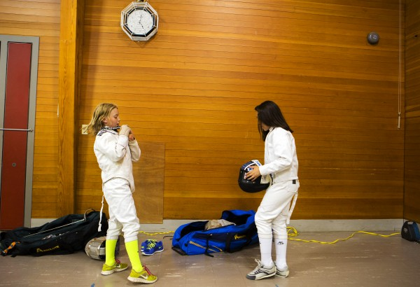 Erin Gerbi (left), 11, and Lily Millard, 9, gear up to practice their fencing during the Downeast School of Fencing class at the Herbert Sargent Community Center in Old Town.