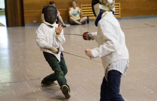 James King (left), 10, tries to parry an attack from Izaak Swartz, 10, during a foil match at the Downeast School of Fencing class at the Herbert Sargent Community Center in Old Town.