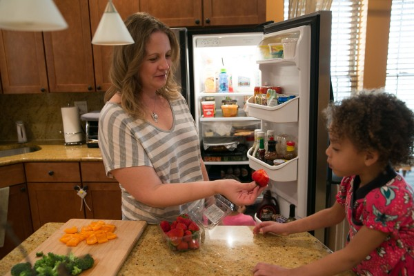 Jennifer Leigh, with her daughter Janelle at home in Evanston, Illinois, lost her sense of smell and has adapted to daily tasks such as cooking by relying on past experience.