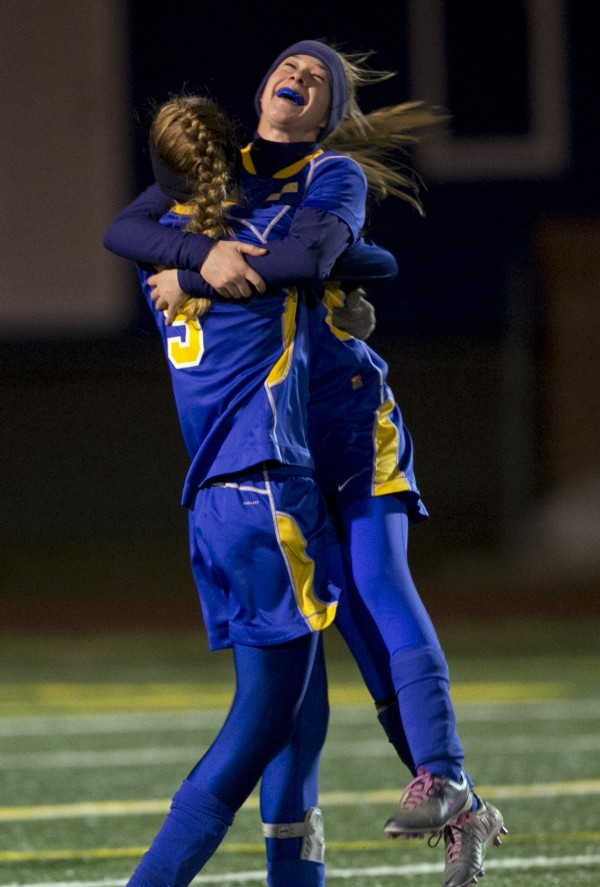 Washburn's Mackenzie Worcester, right, celebrates with a hug from teammate Joan Overman after defeating Richmond in the Class D soccer state championship, 2-1, Nov. 9, 2013, in Bath, Maine. Washburn was the No. 1 seed in Eastern Maine Class D. During the 2013-14 school year, 28 of the 42 boys and girls state champions crowned — 67 percent — were No. 1 seeds in their regions.