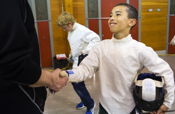 James King (right), 10, shakes hands with instructor John Krauss at the end of the Downeast School of Fencing class at the Herbert Sargent Community Center in Old Town.