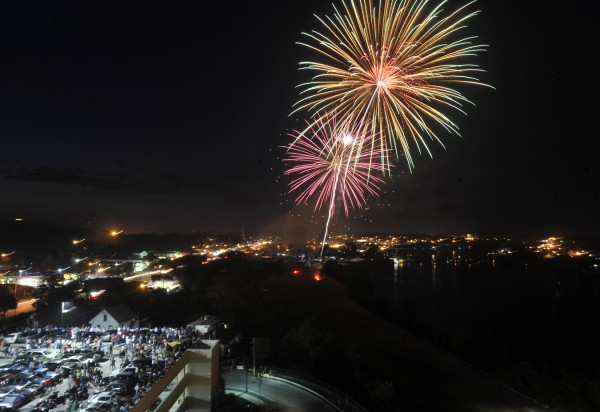 Viewed from atop Hollywood Slots Hotel, thousands watch the Fourth of July fireworks explode over the Penobscot River between Bangor and Brewer.