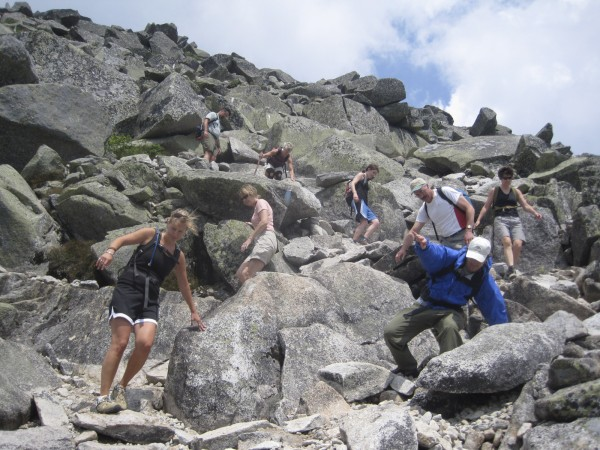 A group of friends and family hiking down Abol Trail, Mount Katahdin.