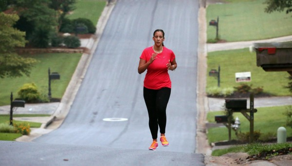 Bianca Cooper runs in Marietta, Ga., neighborhood, June 18, 2014. Cooper can run again, something she used to enjoy a lot in her Marietta subdivision before her stroke last year at age 29.