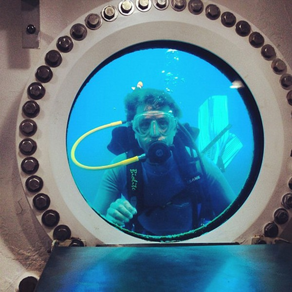 Fabien Cousteau, grandson of underwater pioneer Jacques-Yves Cousteau, looks through the window of the Aquarius habitat located 63 feet (19.2 meters) below the surface of the ocean near the deep coral reef in the Florida Keys National Marine Sanctuary.