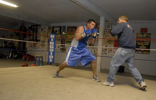 Bangor boxer Josh McAufliffe trains with Ken Wyman in the ring at Wyman's club in Stockton Springs in this Jan. 4, 2010 photo.