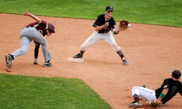 BANGOR, MAINE -- 06/21/14 -- Greely's Patrick O'Shea (center) catches a toss from teammate Calvin Soule (right) to get Caribou's Cody Herbert out at second during their Class B baseball state championship game at Mansfield Stadium Saturday. Greely won 1-0.