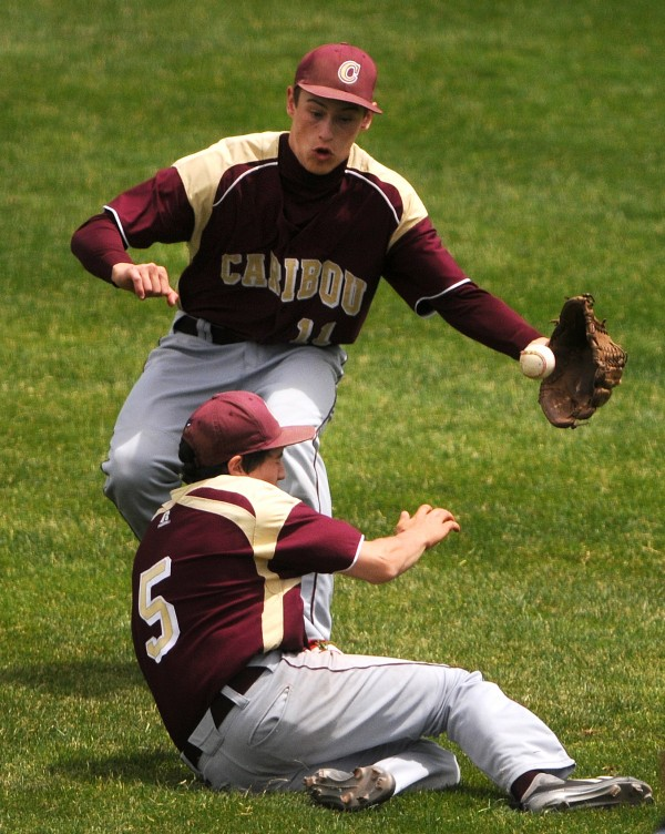 BANGOR, MAINE -- 06/21/14 -- Caribou's Mason Huck (left) and Michael Hunter nearly collide missing a ball from Greely during their Class B baseball state championship game at Mansfield Stadium Saturday. Greely won 1-0.