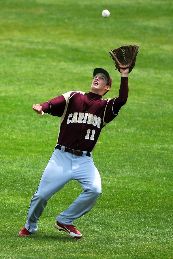 BANGOR, MAINE -- 06/21/14 -- Caribou's Mason Huck catches a fly ball from Greely during their Class B baseball state championship game at Mansfield Stadium Saturday. Greely won 1-0.