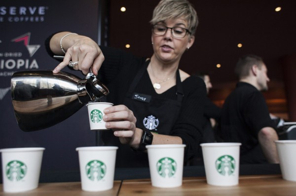Barista Sandy Roberts pours samples of Starbucks coffee during the company's annual shareholders meeting in Seattle, Washington in this file photo taken March 19, 2014.