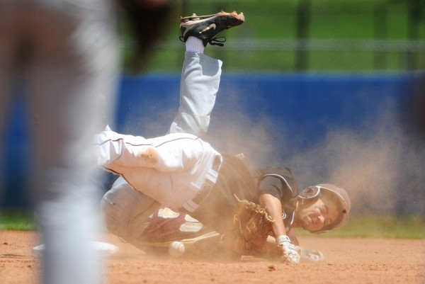 BANGOR, MAINE -- 06/21/14 -- Greely's Austin Nowinski (seen) collides with Caribou's Matthew Milliard at second during their Class B baseball state championship game at Mansfield Stadium Saturday. Nowinski was called out at second. Greely won 1-0.