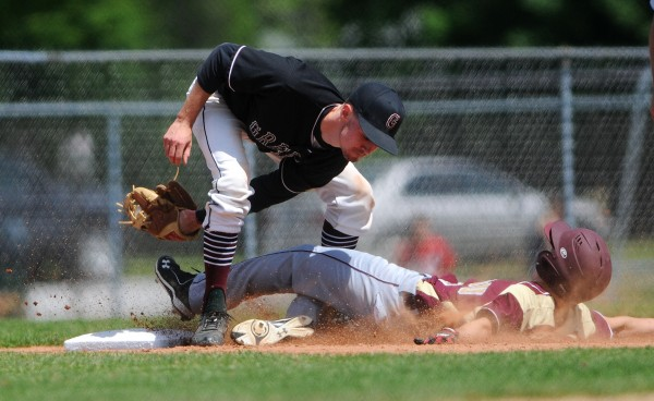 BANGOR, MAINE -- 06/21/14 -- Greely's Sameul Porter (left) tags out Caribou's Dustin Bouchard during their Class B baseball state championship game at Mansfield Stadium Saturday. Greely won 1-0.