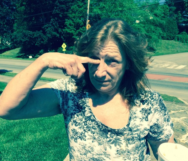Ellsworth resident Vicki Barnard, 56, whose husband Jeffrey Paul Barnard, 50, was shot  June 1 by Maine State Police Trooper Scott Duff after a shootout and lengthy standoff with police, indicates on her face where the bullet entered her husband's eye socket.