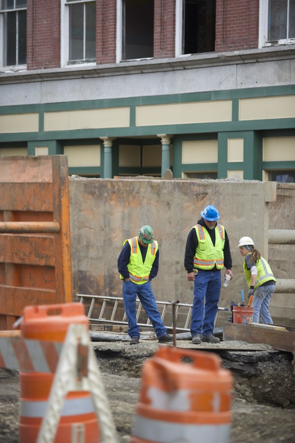 Construction crews work on underground infrastructure Friday in West Market Square.