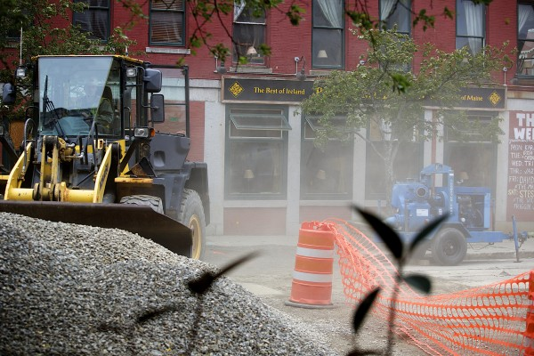 Dust is blown around from the gusty winds on Friday afternoon in West Market Square.