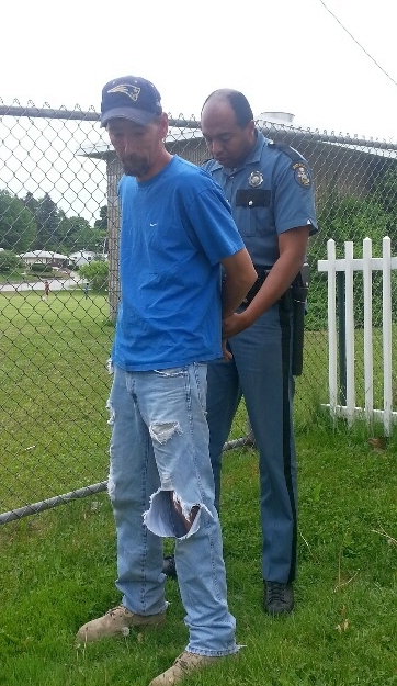 James Bellanceau was handcuffed by State Trooper Elgin Physic on Thursday night following his arrest for failing to pay child support.