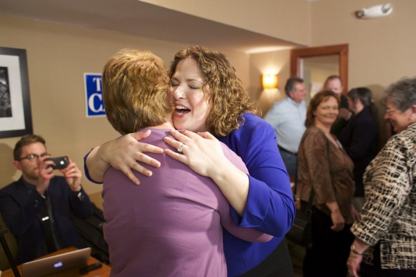 Emily Cain hugs a supporter after delivering her victory speech for the Democratic 2nd Congressional District seat Tuesday evening at the Holiday Inn in Bangor.