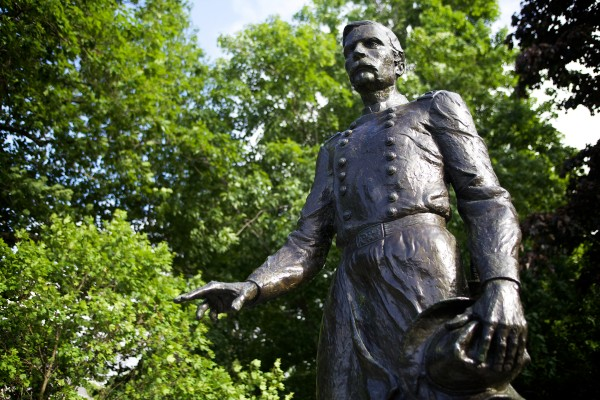 A statue of Joshua Chamberlain stands sentinel near an entrance to Bowdoin College in Brunswick on Thursday, where he served as president. Chamberlain died 100 years ago of a wound he received 50 years earlier in Petersburg, Virginia. History buff Dean Clegg is raising money for a marker to placed near the spot where he was wounded.