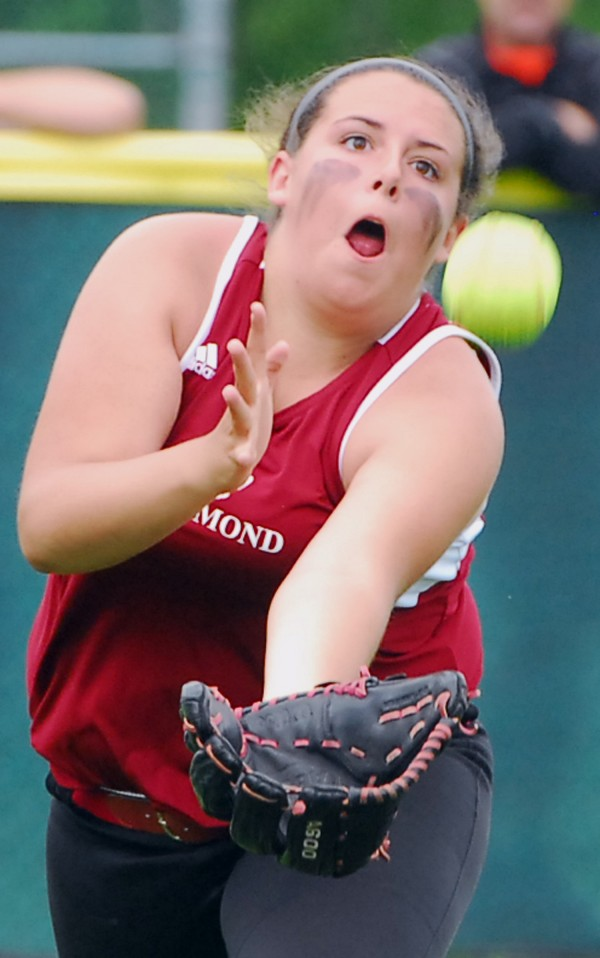Richmond High School left fielder Emily Douin (19) comes up just short attempting to run down a fly ball hit by a Limestone batter during the Class D state softball final at Coffin Field in Brewer Saturday.