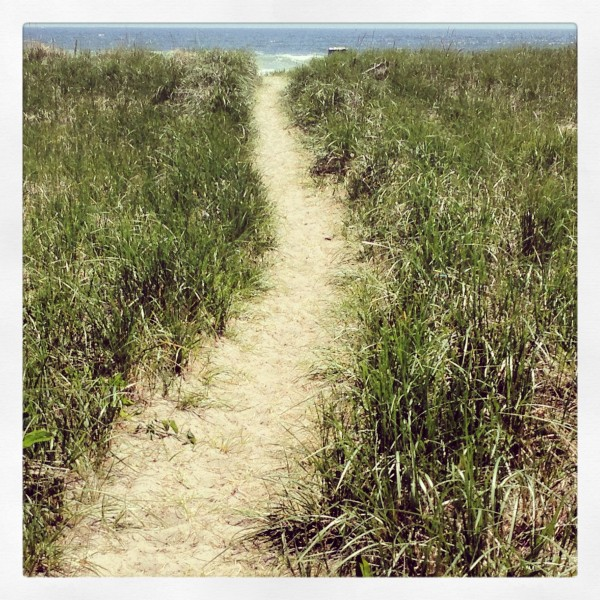 A path leads to Old Orchard Beach in Maine in early June.