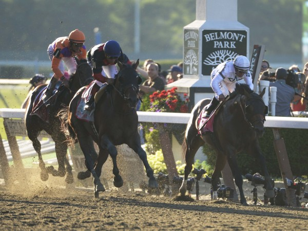 Joel Rosario aboard Tonalist (11) wins the 2014 Belmont Stakes at Belmont Park in Elmont, New York.