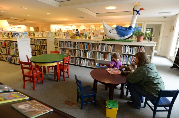 Kim Corriveau reads to her 2-year-old granddaughter Lucy Nicols on Friday morning in the children's area of the Bangor Public Library.