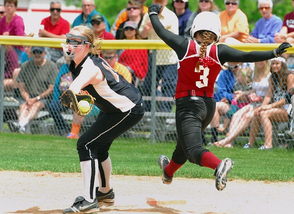 Richmond High School's Camryn Hurley is thrown out at first on a close play as Limestone's Madeline Williams holds on to the throw during the Class D state softball final at Coffin Field in Brewer Saturday.