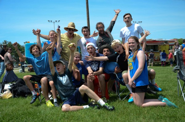 The Belfast Ultimate Frisbee club team celebrates Saturday after winning the Class B state high school championship in Portland.