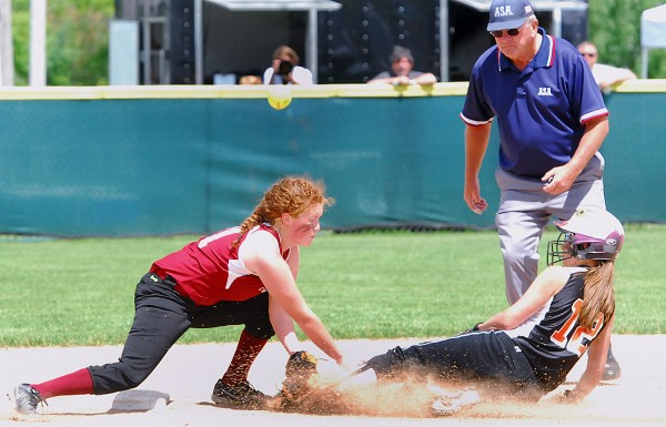 Limestone's Ellyzabeth Bencivenga steals second as the throw gets past Richmond High School's Kalah Patterson during the Class D State Championship at Coffin Field in Brewer Saturday.