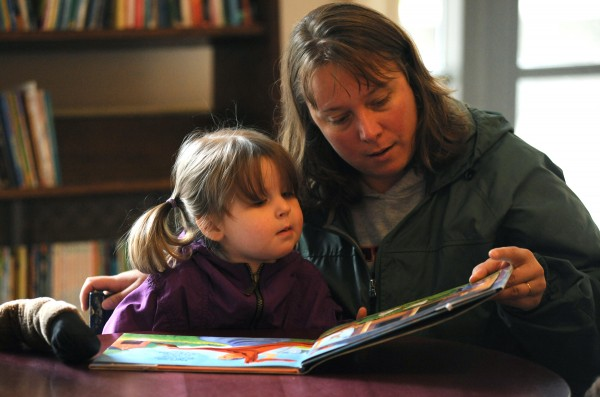 Kim Corriveau reads to her 2-year-old granddaughter Lucy Nicols on Friday morning at the Bangor Public Library.
