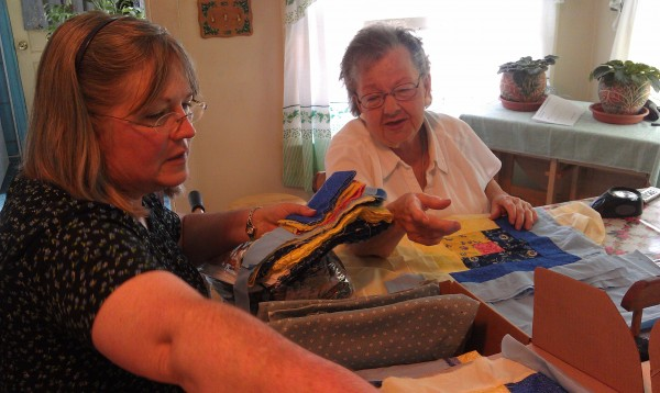 Dot MacDonald, 84, of Portland, examines quilt scraps with Karen McKenna, a vision rehabilitation therapist at the Iris Network, on June 17, 2014. McKenna has helped MacDonald adjust to vision loss.